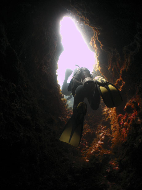 Passing through the chimney at The Blue Hole