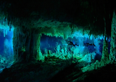 The Cascade Room, some 80 feet beneath the surface, leads divers deeper into Dan's Cave on Abaco Island. - Wes C. Skiles