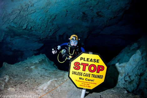 The STOP sign inside Dan's Cave. Cavern divers should not go past this sign.