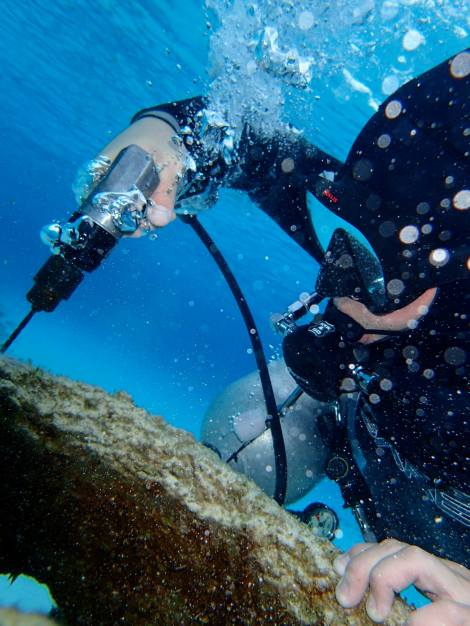 Me drilling into a reef ball